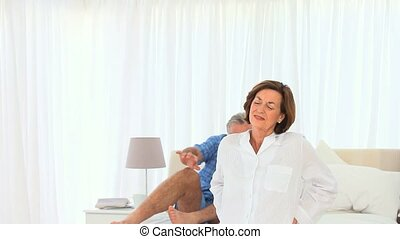 Elderly man giving his wife a massage