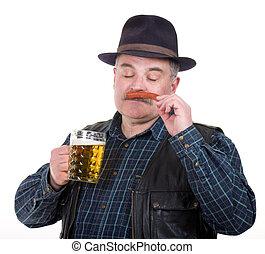 Elderly man holding a beer