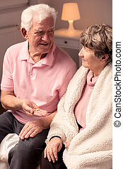 Elderly man holding pills