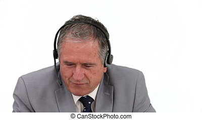 Elderly man in a call center having a phone call