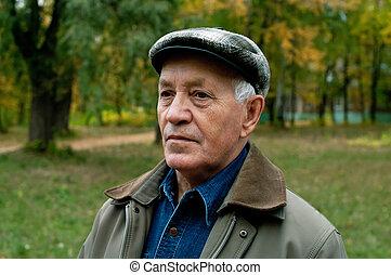 elderly man in a cap