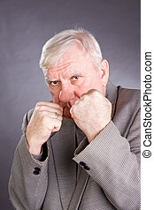 Elderly man in a pose of boxer