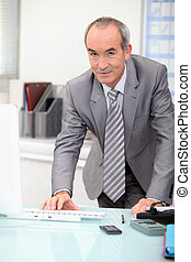 Elderly man in office
