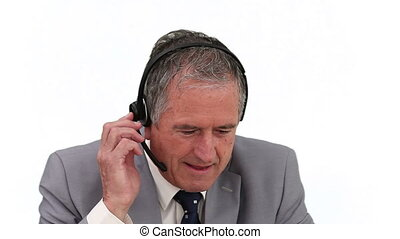 Elderly man in suit talking on the phone