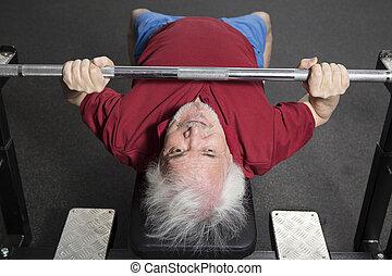 Elderly man in the gym