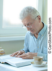 Elderly man is resting at home
