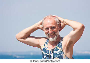 Elderly man on the background of the sea