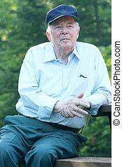 Elderly man outdoors - Elderly man enjoying his rest ...