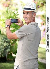 Elderly man photographed in the garden