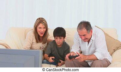 Elderly man playing video games