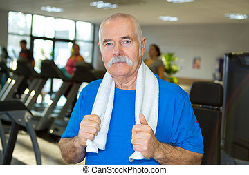elderly man posing in the gym