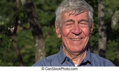Elderly Man Posing Outdoors