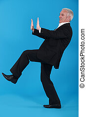Elderly man pushing object