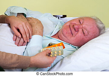 Elderly man receiving medication