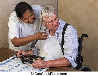 Elderly man refusing to drink water