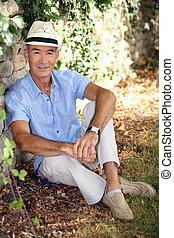 Elderly man relaxing in his garden