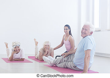 Elderly man relaxing on mat