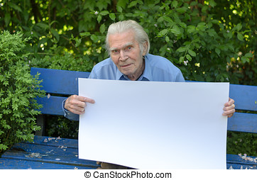 Elderly man showing a blank whiteboard
