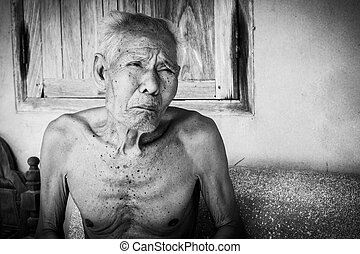 Elderly man sitting alone on the chair