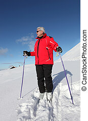 Elderly man skiing