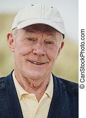 Elderly Man Smiling at the Beach