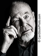 elderly man - Portrait of old man over black background. Old...