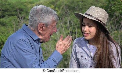 Elderly Man Talking To Girl