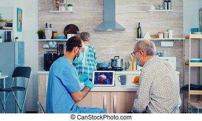 Elderly man talking with doctor