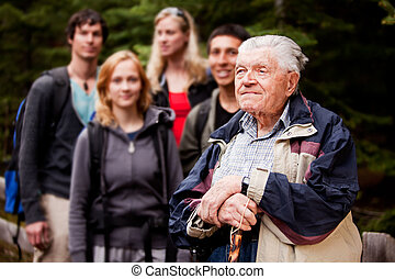Elderly Man Tour Guide - An elderly man giving a tour for a...