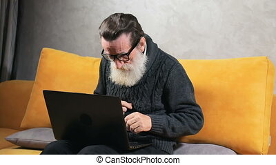 Elderly Man Tries to Find Appropriate Button - Persistent...