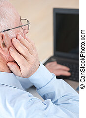 Elderly man using computer