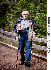 Elderly man Walking - An elderly man walking on a path...