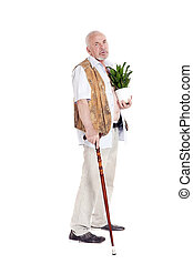 Elderly man with a cane and flowerpot in hand
