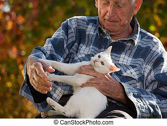Elderly man with cat