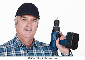 Elderly man with drill