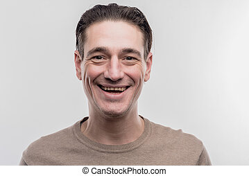 Elderly man with facial wrinkles laughing out loud