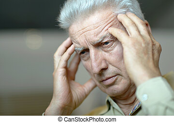 Elderly man with headache