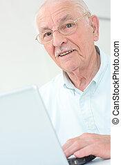 elderly man with laptop