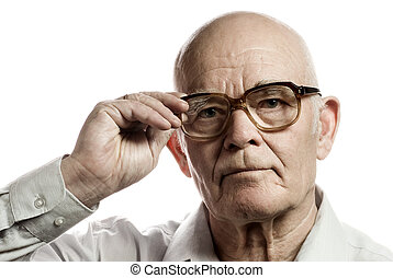 Elderly man with massive glasses isolated on white...