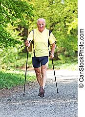 Elderly man with Nordic walking