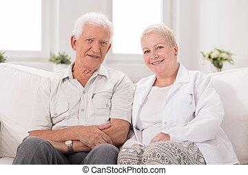 Elderly man with nurse
