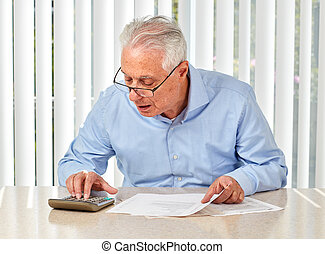 Elderly man with papers.