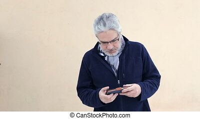 Elderly man with smart phone
