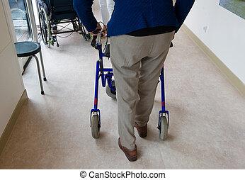 Elderly man with walking frame