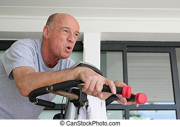 Elderly man working out