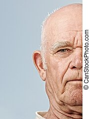 Elderly man's face over blue background