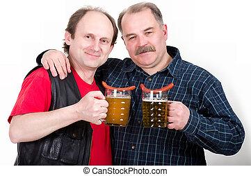 Elderly men holding a beer