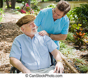 Elderly Patient and Nurse - Disabled senior man in the...