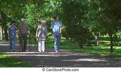 Elderly Patients - Two senior patients with walker...