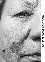 Elderly pensioner female half face portrait closeup